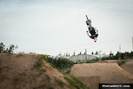 Andrés fliping the last jump from La Poma Bike Park.